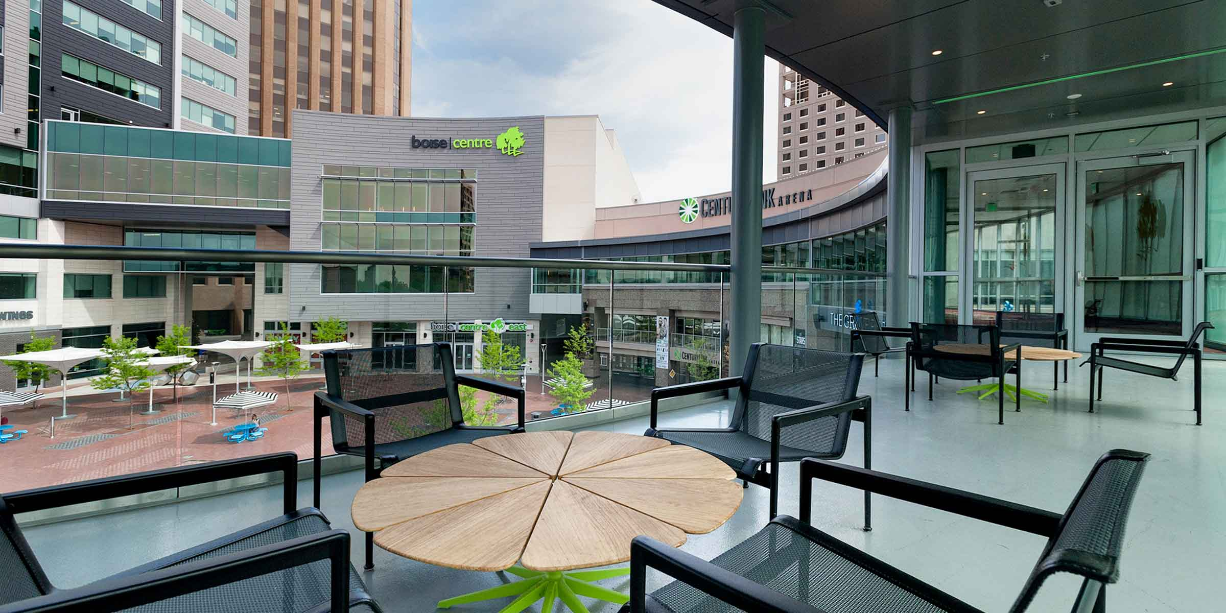 Modern patio table and chairs overlooking Centurylink Arena and Grove Plaza